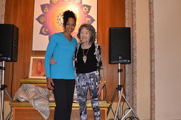 Teresa Kay-Aba Kennedy and 96-year-old yoga master Tao Porchon-Lynch