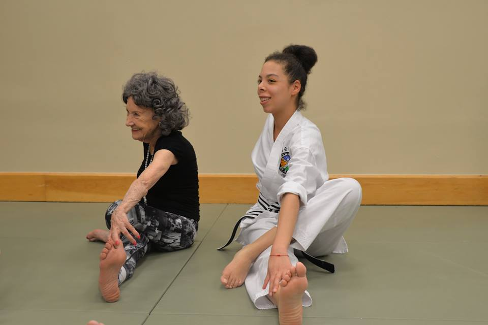 96-year-old yoga master Tao Porchon-Lynch teaching at Harmony By Karate in NYC