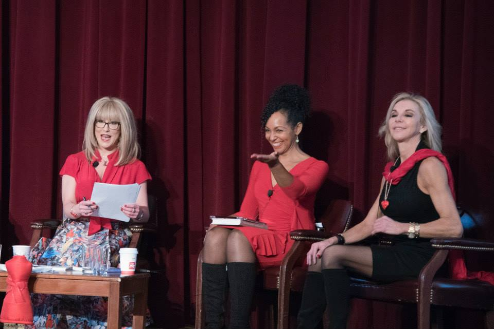 Teresa Kay-Aba Kennedy speaking and acknowledging 96-year-old Yoga Master Tao Porchon-Lynch at the 2015 American Heart Association Go Red Educational Panel at the NY Hilton Midtown