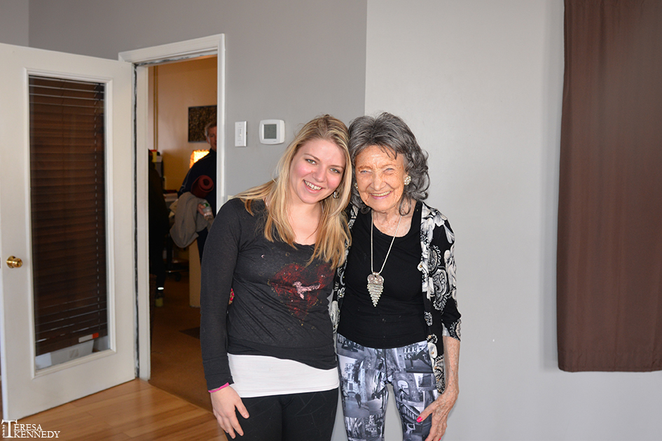 96-year-old Yoga Master Tao Porchon-Lynch with a student at YogaWorks in Irvington, NY