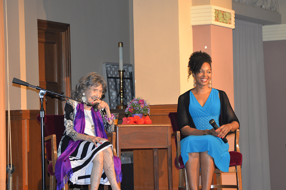 97-year-old yoga master Tao Porchon-Lynch and Teresa Kay-Aba Kennedy in