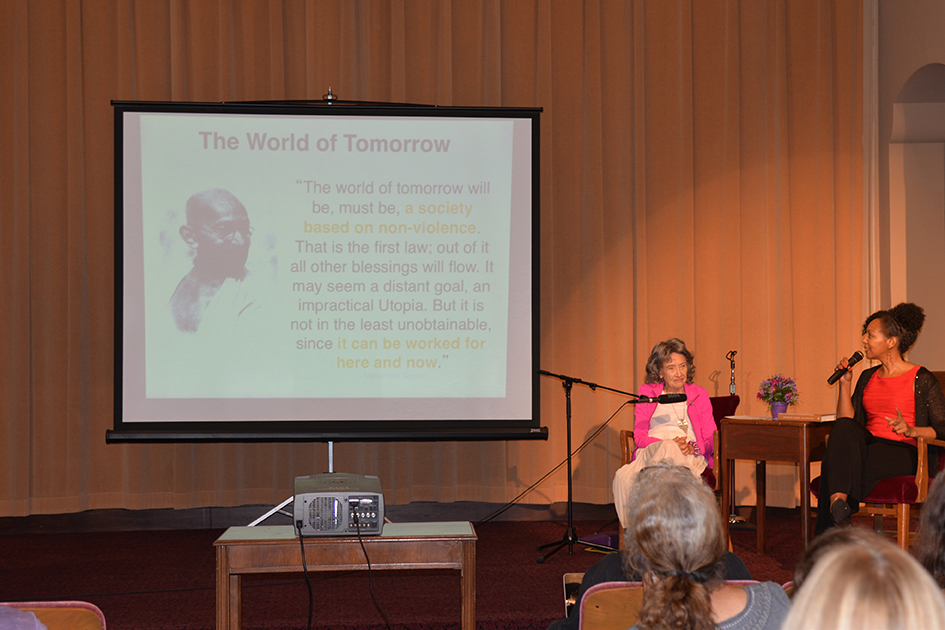 97-year-old yoga master Tao Porchon-Lynch and Teresa Kay-Aba Kennedy leading The Gandhi Effect workshop in Kansas City