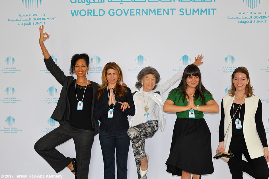 98-year-old yoga master Tao Porchon-Lynch with World Economic Forum Young Global Leaders including Teresa Kay-Aba Kennedy at Mina A' Salam in Dubai for World Government Summit - February 13, 2017