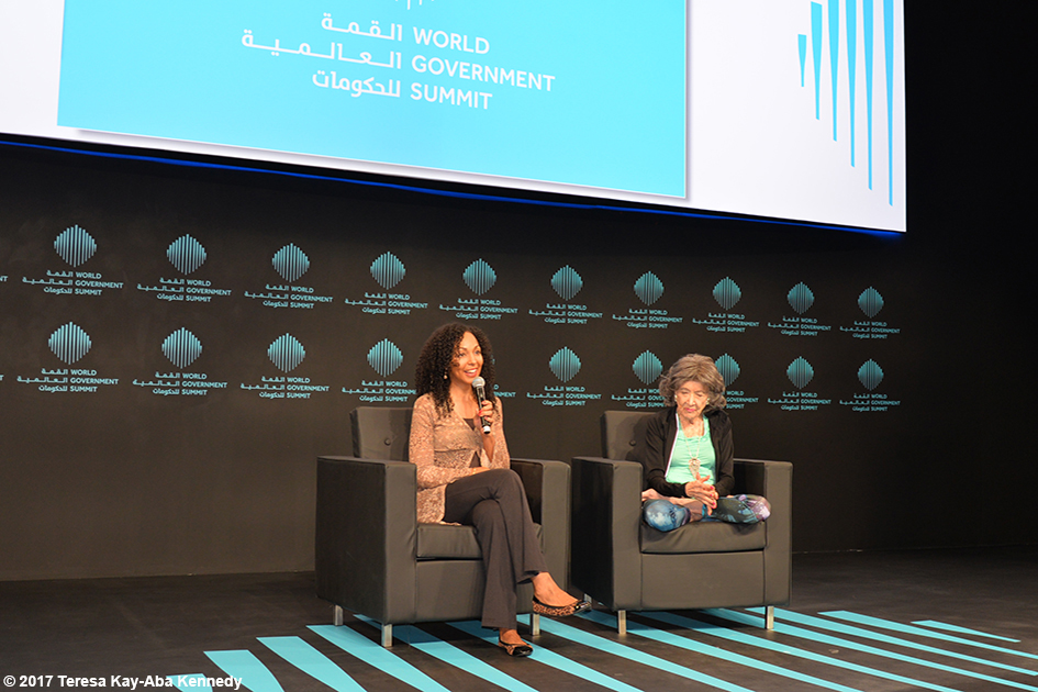 Teresa Kay-Aba Kennedy and 98-year-old yoga master Tao Porchon-Lynch presenting at the World Government Summit in Dubai - February 14, 2017