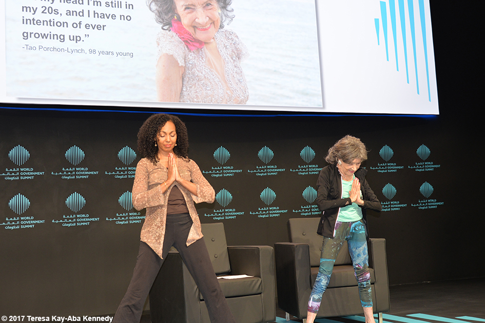 98-year-old yoga master Tao Porchon-Lynch and Teresa Kay-Aba Kennedy presenting at the World Government Summit in Dubai - February 14, 2017