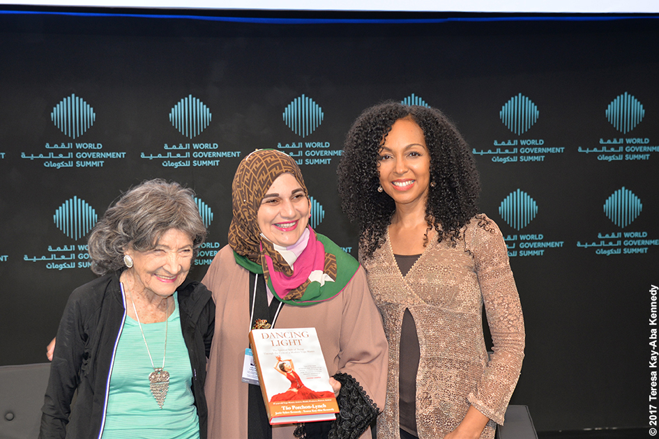 98-year-old yoga master Tao Porchon-Lynch and Teresa Kay-Aba Kennedy and Alaa Ershead at the World Government Summit in Dubai - February 14, 2017