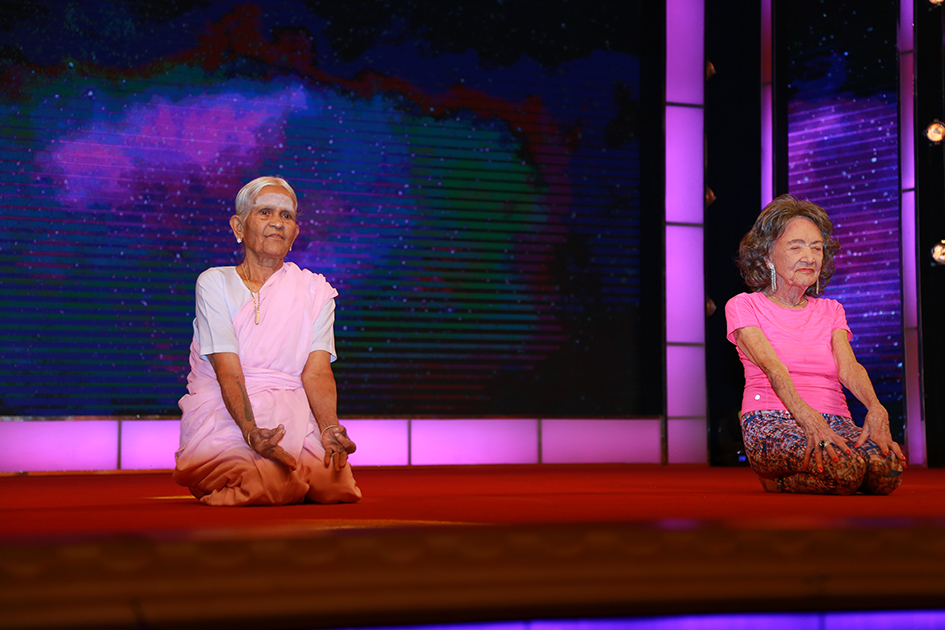 97-year-old Amma V. Nanammal and 98-year-old Tao Porchon-Lynch demonstrating asanas during Yoga Ratna Awards in Bangalore, India - June 20, 2017