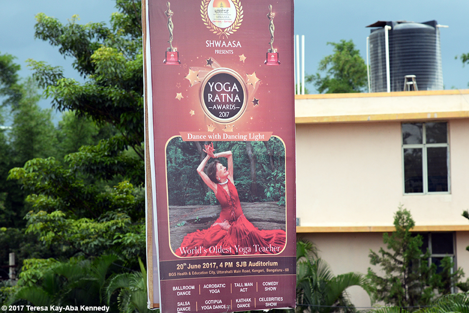 Street Sign featuring 98-year-old yoga master Tao Porchon-Lynch at the 2017 Yoga Ratna Awards in Bangalore, India - June 20, 2017