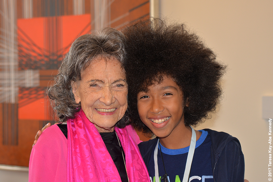 99-year-old yoga master Tao Porchon-Lynch with 12-year-old yoga teacher Tabay Atkins at Lead With Love Conference in Aspen, Colorado – October 26, 2017