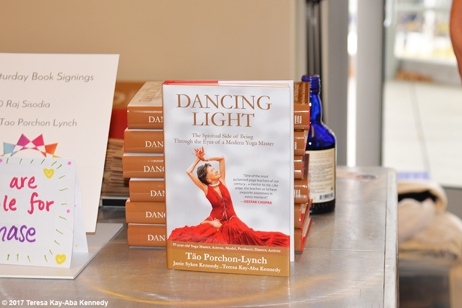 99-year-old yoga master Tao Porchon-Lynch's award-winning autobiography Dancing Light at Explore Booksellers book signing at Lead With Love Conference in Aspen, Colorado – October 27, 2017