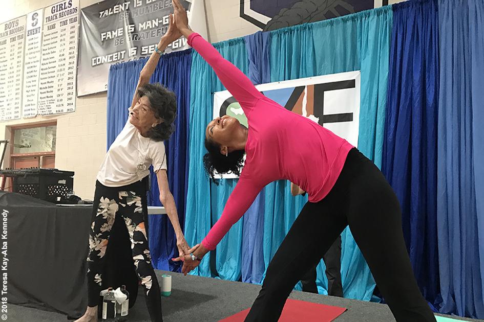 99-year-old yoga master Tao Porchon-Lynch and Teresa Kay-Aba Kennedy at the Sedona Yoga Festival - February 10, 2018