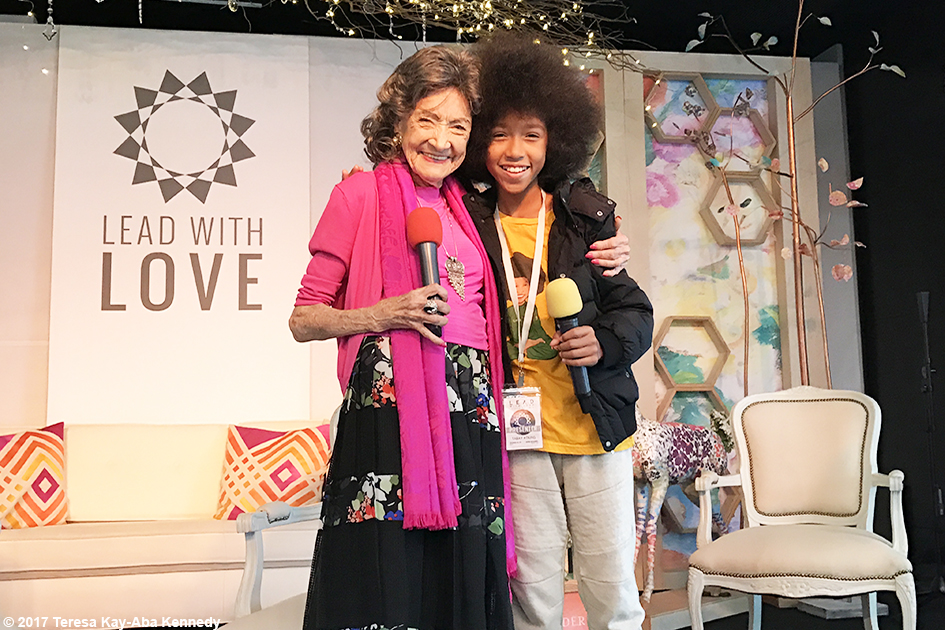 99-year-old yoga master Tao Porchon-Lynch and 12-year-old yoga teacher Tabay Atkins at Lead With Love Conference in Aspen, Colorado – October 27, 2017