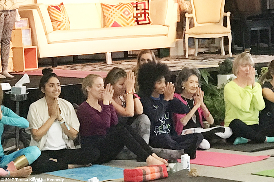 99-year-old yoga master Tao Porchon-Lynch and 12-year-old Tabay Atkins teaching at Lead With Love Conference in Aspen, Colorado – October 27, 2017