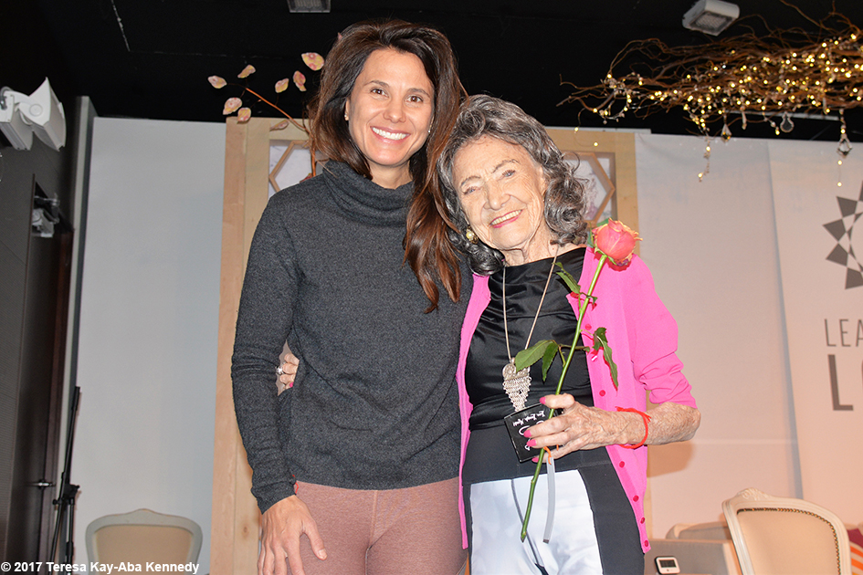 Gina Murdock and 99-year-old yoga master Tao Porchon-Lynch at Lead With Love Conference in Aspen, Colorado – October 27, 2017