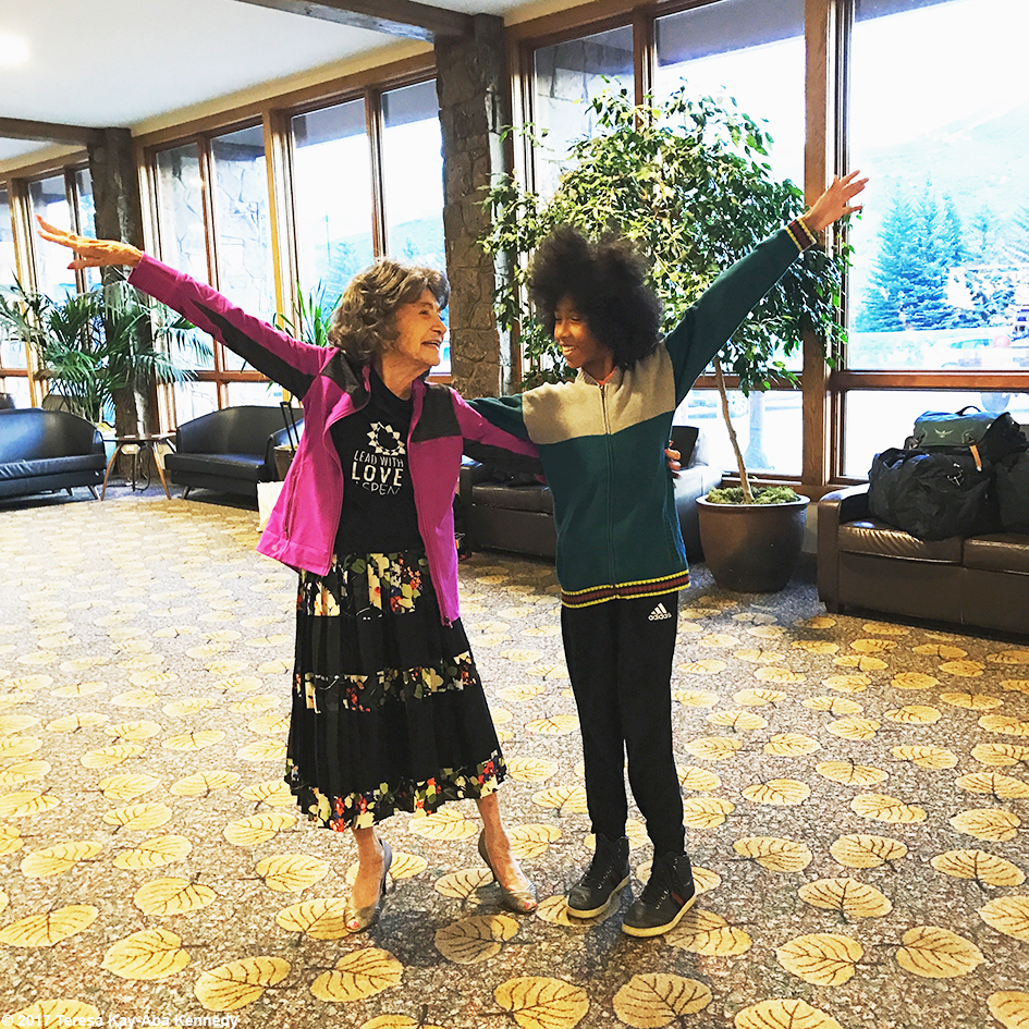 99-year-old yoga master Tao Porchon-Lynch giving 12-year-old yoga teacher Tabay Atkins his first dance lesson at the Aspen Airport going home from Lead With Love Conference in Aspen, Colorado – October 28, 2017