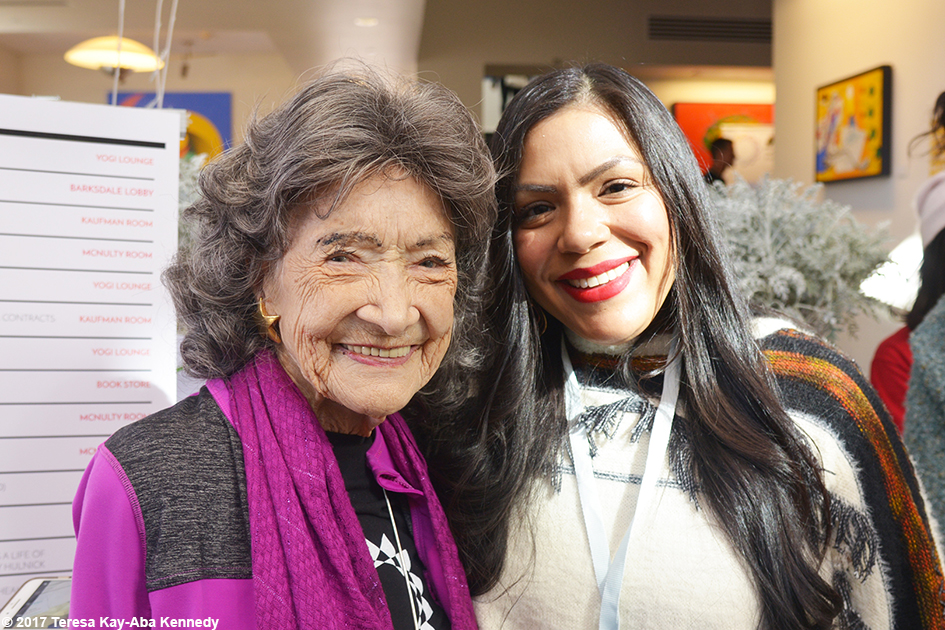 99-year-old yoga master Tao Porchon-Lynch and Stephanie Alvarez at Lead With Love Conference in Aspen, Colorado – October 28, 2017