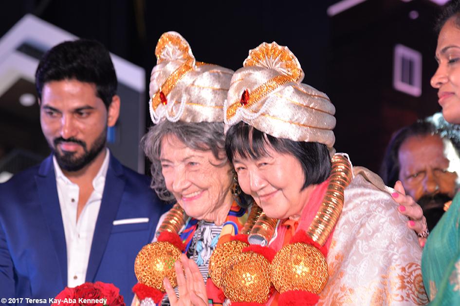 98-year-old yoga master Tao Porchon-Lynch and Yogamata Keiko Aikawa receiving awards in Bangalore, India - June 19, 2017