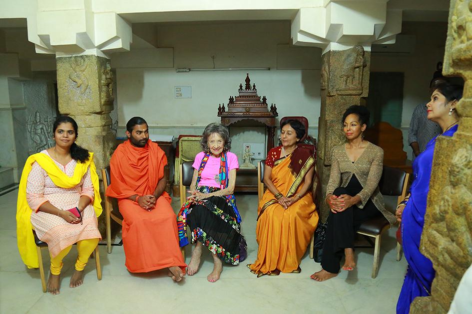 98-year-old yoga master Tao Porchon-Lynch, Shwaasa Guru, Teresa Kay-Aba Kennedy and others waiting to see 110-year-oldShivakumara Swami at theSree Siddaganga Matha in Karnataka, India - June 23, 2017