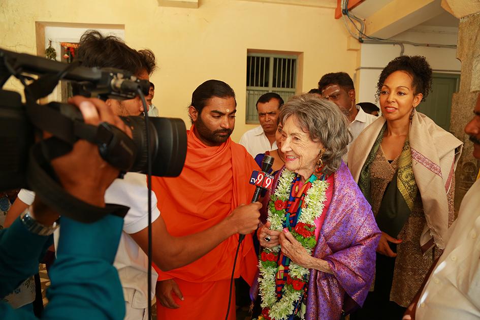 98-year-old yoga master Tao Porchon-Lynch being interviewed about meeting 110-year-oldShivakumara Swami at theSree Siddaganga Matha in Karnataka, India - June 23, 2017