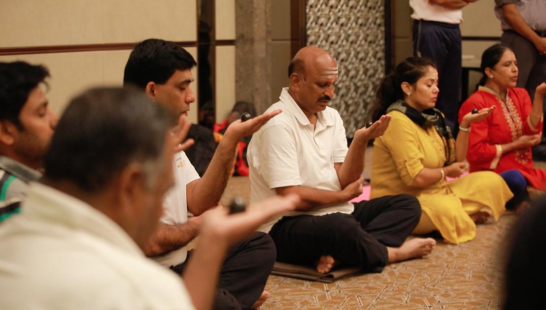 Participants doing an Isthalinga Meditation in Bangalore, India - June 24, 2018