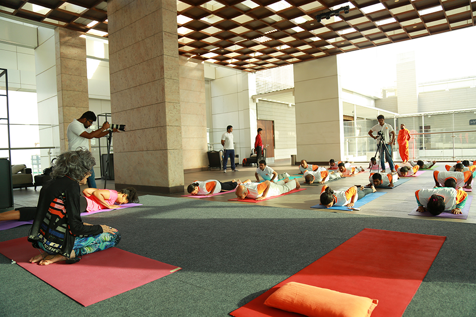 98-year-old yoga master Tao Porchon-Lynch teaching yoga with Teresa Kay-Aba Kennedy demonstrating in Bangalore, India - June 22, 2017