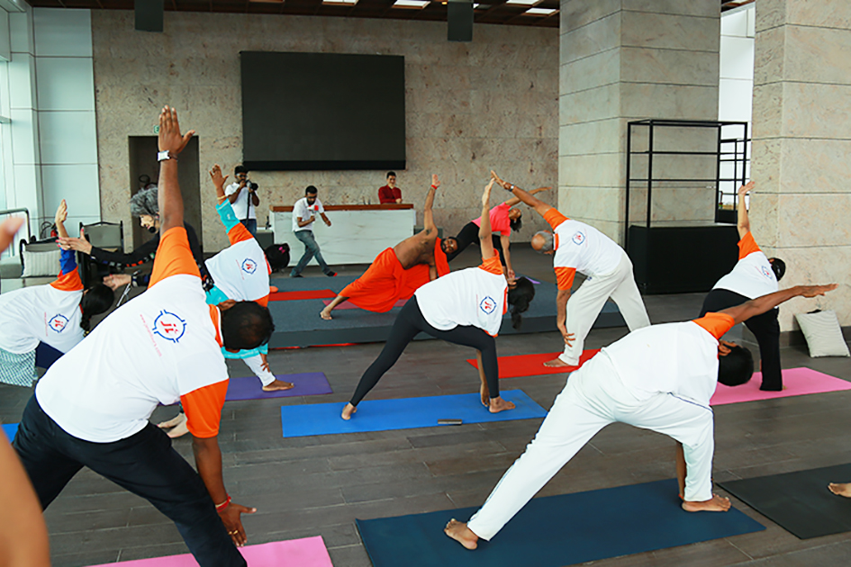 98-year-old yoga master Tao Porchon-Lynch teaching yoga with Teresa Kay-Aba Kennedy and Shwaasa Guru demonstrating in Bangalore, India - June 22, 2017