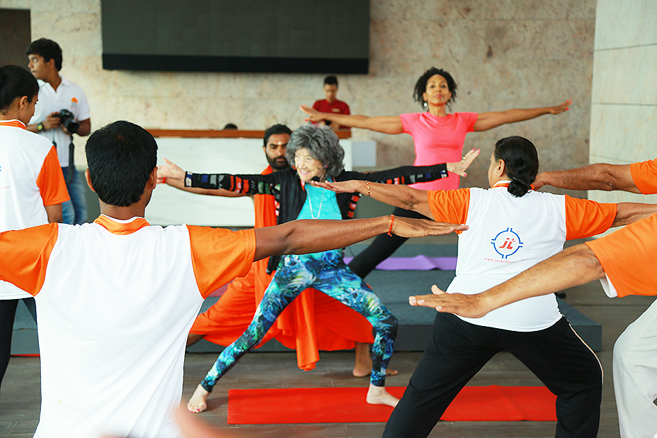 98-year-old yoga master Tao Porchon-Lynch teaching yoga with Teresa Kay-Aba Kennedy and Shwaasa Guru assisting in Bangalore, India - June 22, 2017