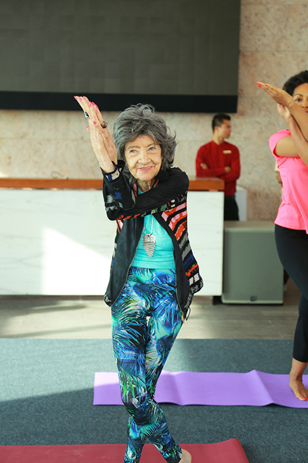 98-year-old yoga master Tao Porchon-Lynch teaching yoga with Teresa Kay-Aba Kennedy assisting in Bangalore, India - June 22, 2017