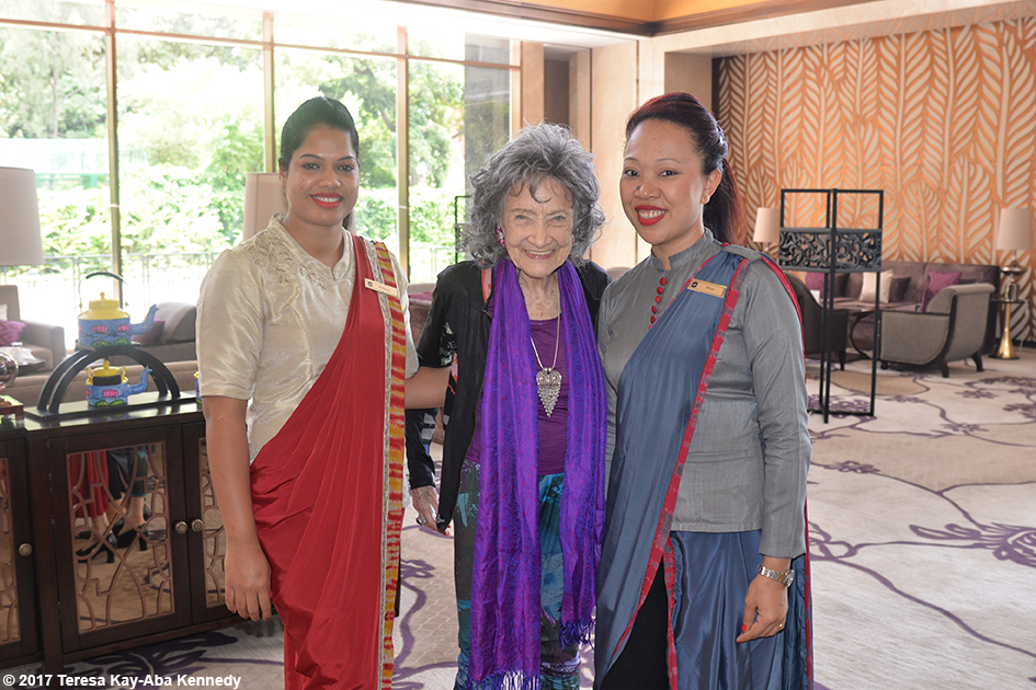 98-year-old yoga master Tao Porchon-Lynch with Margaret and Rinnin from the Shangri-La Hotel in Bangalore, India - June 21, 2017