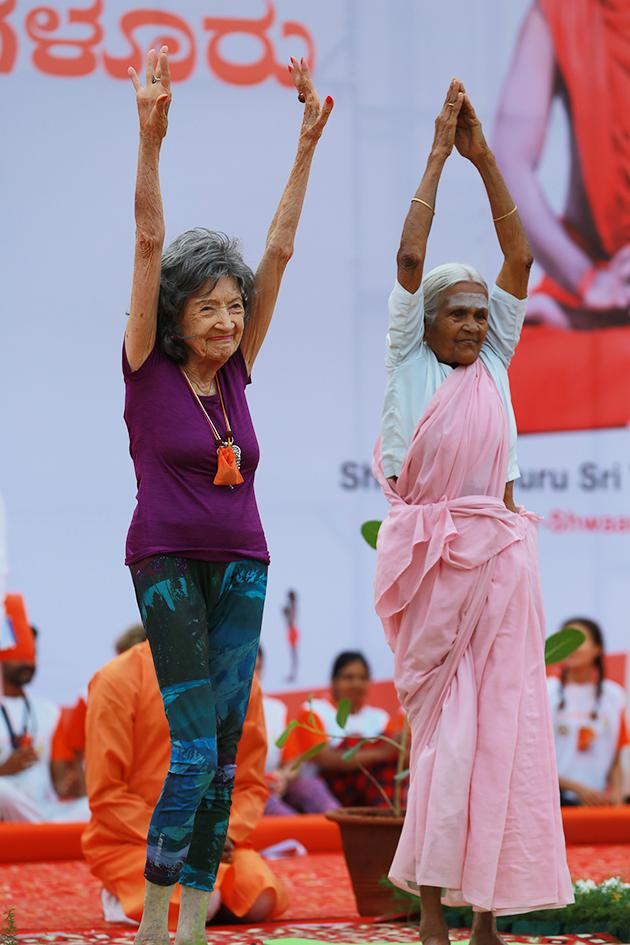 98-year-old yoga master Tao Porchon-Lynch and 97-year-old Amma V. Nanammal demonstrating yoga on stage at International Day of Yoga at Kanteerava Outdoor Stadium in Bangalore, India - June 21, 2017