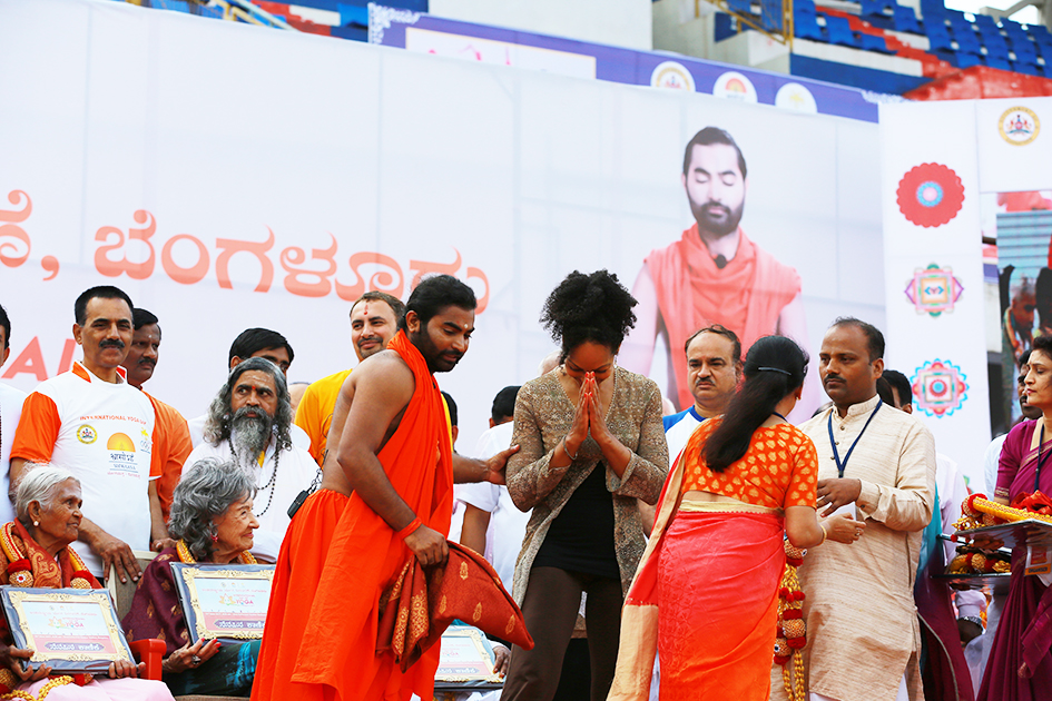 Teresa Kay-Aba Kennedy being honored on stage at International Day of Yoga at Kanteerava Outdoor Stadium in Bangalore, India - June 21, 2017