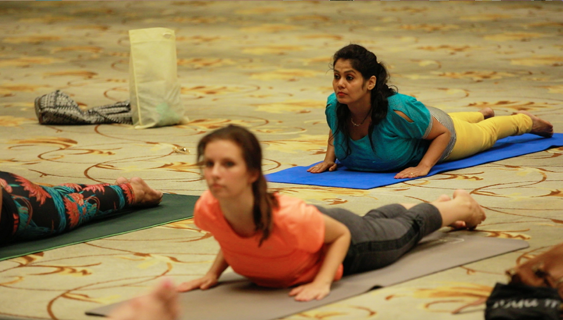 98-year-old yoga master Tao Porchon-Lynch teaching yoga with Teresa Kay-Aba Kennedy demonstrating in Bangalore, India - June 23, 2017