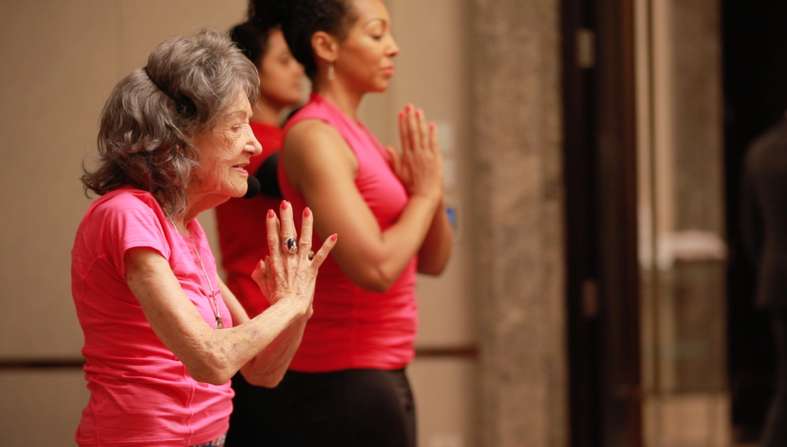 98-year-old yoga master Tao Porchon-Lynch teaching yoga in Bangalore, India with Teresa Kay-Aba Kennedy assisting - June 24, 2017