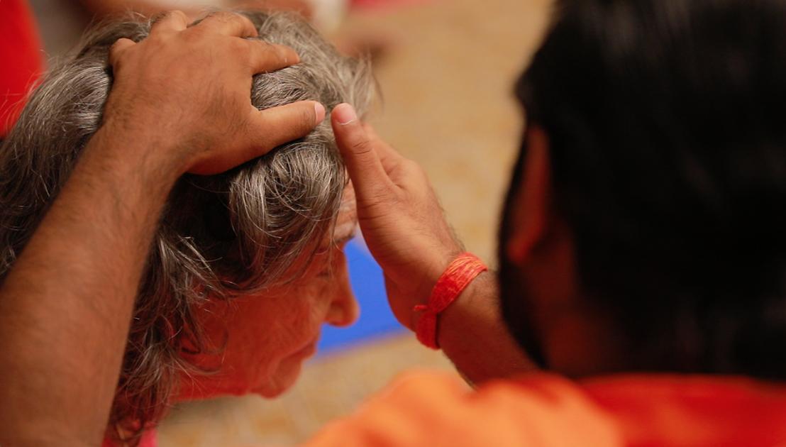 Shwaasa Guru putting Tripundra spiritual markings and bindu on the forehead of 98-year-old yoga master Tao Porchon-Lynch before Ishtalinga Meditation Bangalore, India - June 24, 2018
