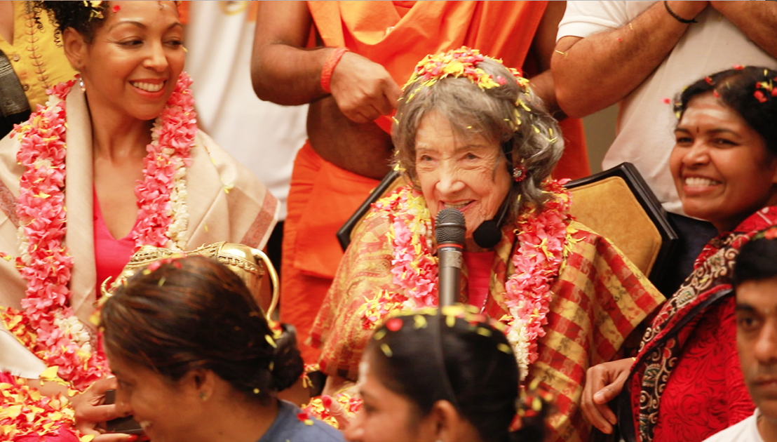 98-year-old yoga master Tao Porchon-Lynch with Teresa Kay-Aba Kennedy receiving honors in a ceremony in Bangalore, India - June 24, 2017