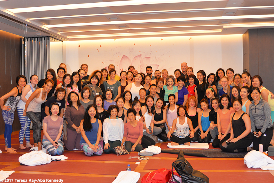 Class photo after yoga session with 99-year-old yoga master Tao Porchon-Lynch at Pure Yoga in Hong Kong – December 20, 2017