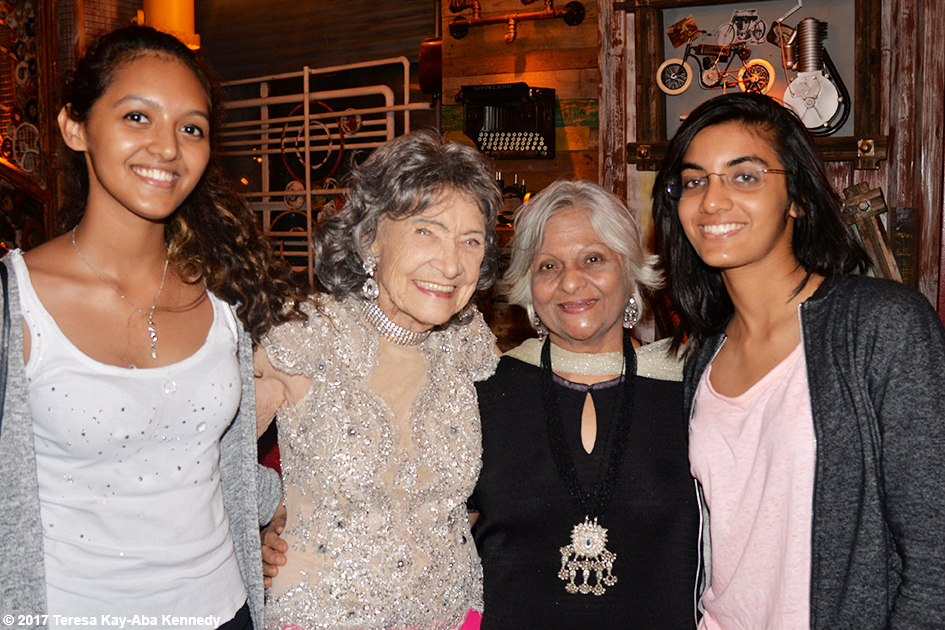 98-year-old Tao Porchon-Lynch with Kumkum Somani and her family at Tao's World Book of Records celebration at Junkyard Cafe in Mumbai, India - June 27, 2017