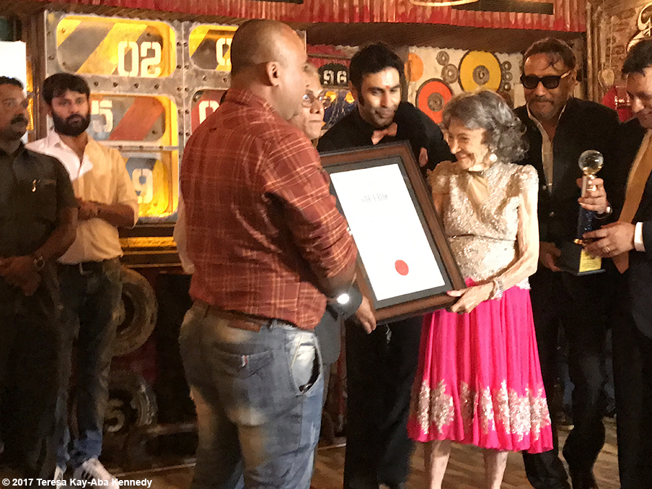 98-year-old Tao Porchon-Lynch being presented the World Book of Records for Oldest Ballroom Dancer by Sandip Soparrkar, Jackie Shroff and others at the Junkyard Cafe in Mumbai, India - June 27, 2017