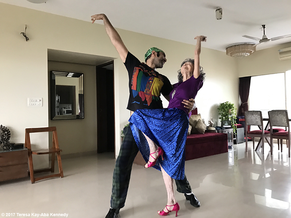 98-year-old yoga master Tao Porchon-Lynch rehearsing with dancer and choreographer Sandip Soparrkar at his home in Mumbai, India - June 26, 2017