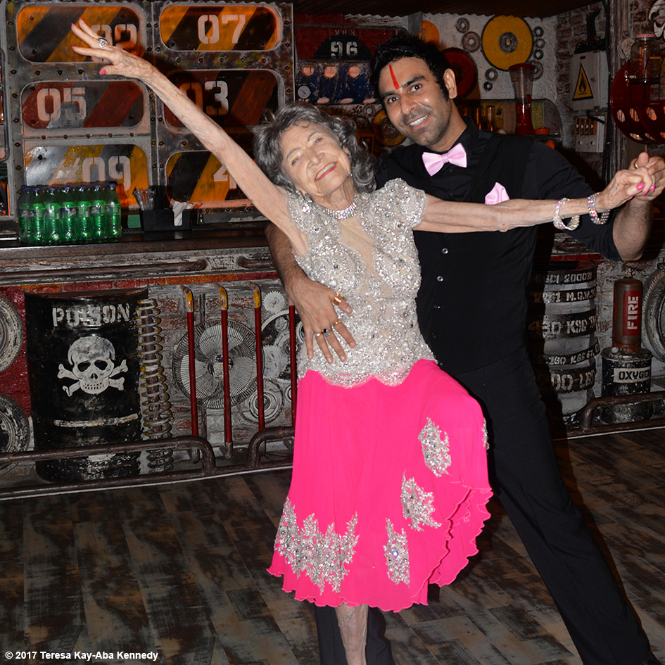 98-year-old Tao Porchon-Lynch dancing with Sandip Soparrkar at her World Book of Records celebration at Junkyard Cafe in Mumbai, India - June 27, 2017