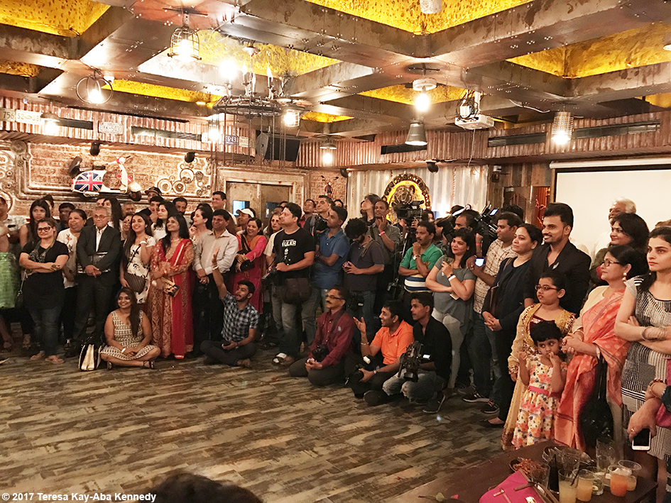 Audience watching 98-year-old Tao Porchon-Lynch dancing with Sandip Soparrkar at her World Book of Records celebration at Junkyard Cafe in Mumbai, India - June 27, 2017