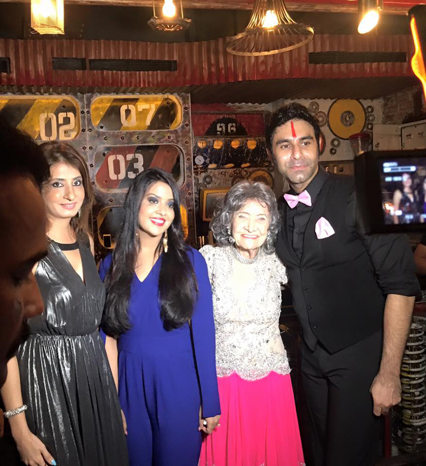 98-year-old Tao Porchon-Lynch with First Lady Amruta Fadnavis and Sandip Soparrkar at Tao's World Book of Records celebration at the Junkyard Cafe in Mumbai, India - June 27, 2017